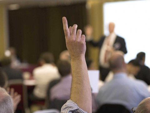 raising-hand-in-class-to-ask-question