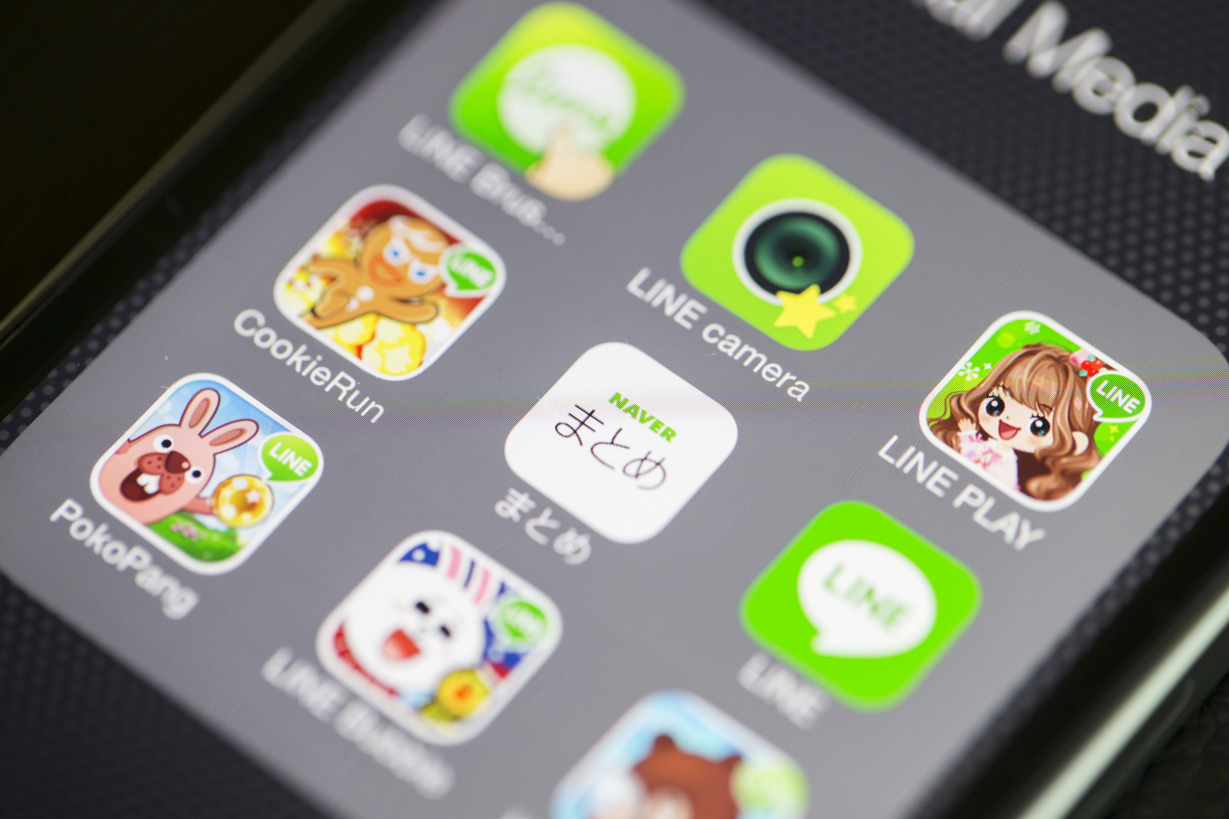 Application icons for Line Corp.'s internet messaging and calling service, controlled by Naver Corp., are displayed on an Apple Inc. iPhone 5s in an arranged photograph in Hong Kong, China, on Tuesday, Feb. 25, 2014. SoftBank Corp. is seeking to buy a stake in Line, people with knowledge of the matter said. Photographer: Brent Lewin/Bloomberg
