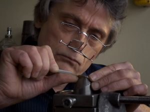 those-double-magnifying-glasses-helped-enhance-the-tiny-stitches-for-the-craftsmen-300x225
