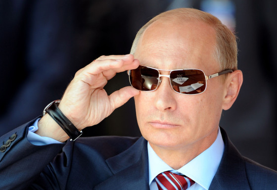 Russian Prime Minister Vladimir Putin adjusts his sunglasses as he watches an air show during MAKS-2011, the International Aviation and Space Show, in Zhukovsky, outside Moscow, on August 17, 2011.